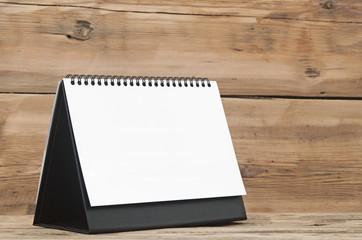 Blank calendar on wood table