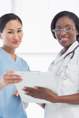 Female doctor and surgeon with report