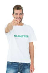Portrait of a happy male volunteer pointing at you