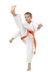 Boy in a kimono beat a high leg kick