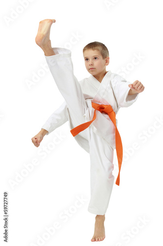 Boy in a kimono beat a high leg kick