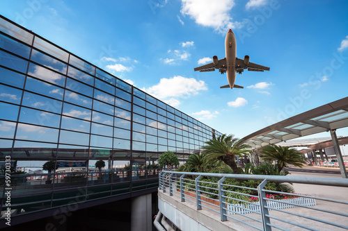 modern airport terminal and aircraft - 59730333