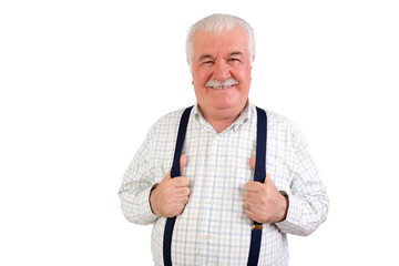 Confident senior man holding his suspenders