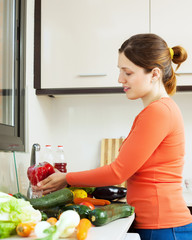 woman washing fresh raw vegetables