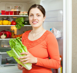 woman with fresh  lettuce