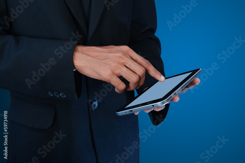 Man hands working on digital tablet