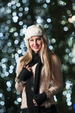 Fashionable lady wearing white fur cap and black muffler outdoor