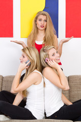 three blonde women