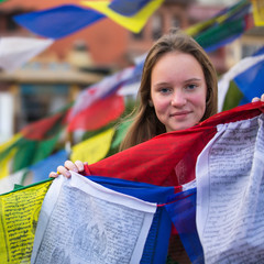 Young girl and Buddhist prayer flags