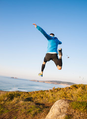 Man giving a big jump and practicing trail running