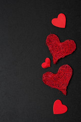 black background with different red hearts