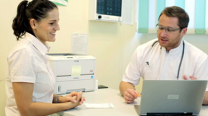 Doctor telling great news to happy female patient