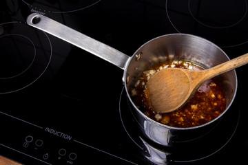 Saucepan with meltet sugar