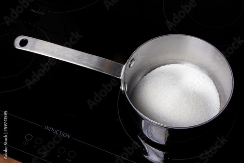 Saucepan with white sugar