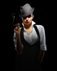 Young woman in manly style with cigar