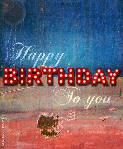 Glowing birthday greetings over distressed paint