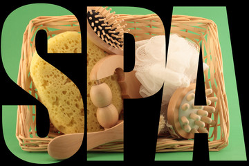 Basket with SPA and beauty articles on green background