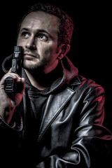 Illegal, thief, armed man with black leather jacket, dangerous