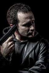 Risk, thief, armed man with black leather jacket, dangerous