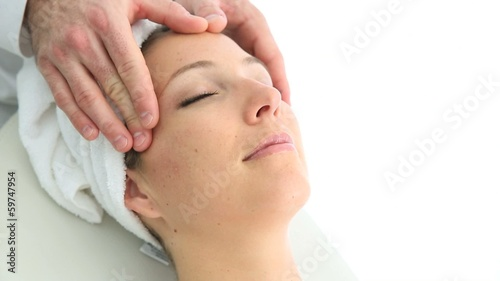 Woman relaxing in spa institute