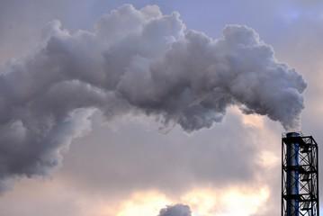 Grey smoke from chimney