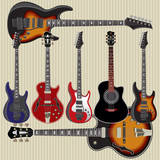 set of guitars on striped background