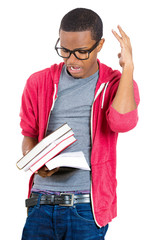 Man, student holding books, anxious in anticipation of finals