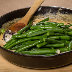 Preparing green beans to make a casserole