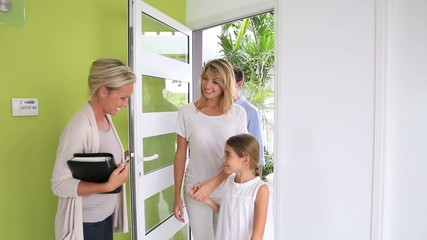 Real Estate agent presenting house to family