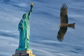 Eagle flying on Statue of Liberty  background