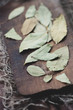 Close-up of bay leaves on a vintage cutting board