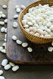 raw white beans in a basket