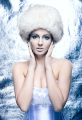 Glamour portrait of a young and beautiful woman in winter style