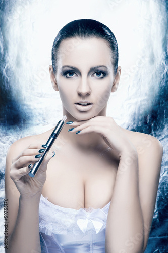 Portrait of a young woman in lingerie smoking an e-cigarette