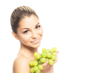 Portrait of a young woman holding fresh and tasty grapes