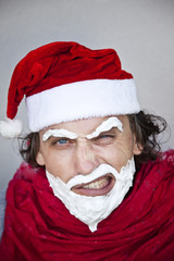 Bad Santa Claus with a beard of shaving cream