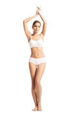 A sporty, fit and beautiful girl isolated on a white background