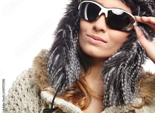 woman in sweater with hood and sunglasses, studio white