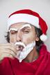 Bad Santa Claus with a beard of shaving cream drink vodka