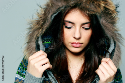 woman in warm winter outfit with closed eyes