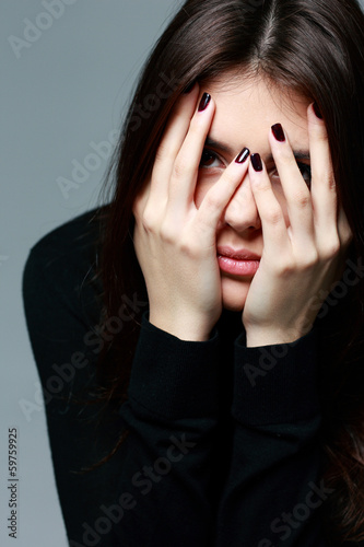Closeup portrait of a woman with hands