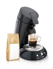 New Coffee maker with full glass of coffee and gold coffe sachet