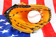 Baseball glove and ball on American flag background