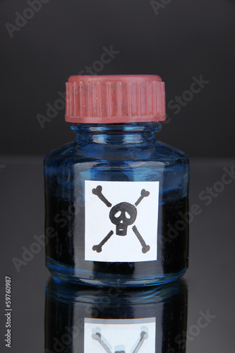Deadly poison in bottle on black background