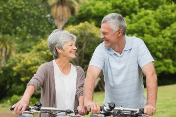 Senior couple on cycle ride at park