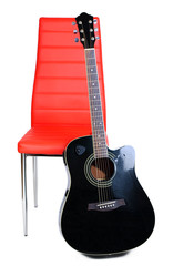 Acoustic guitar  near chair, isolated on white