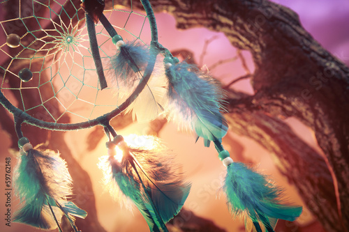 dreamcatcher on a forest at sunset