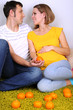 Young pregnant woman with her husband sitting