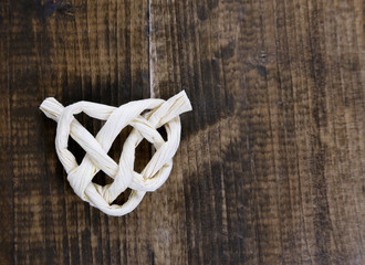 Heart shape from rope, on wooden background