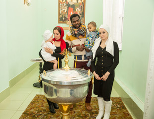 Family celebrating  baptism in Orthodox Church